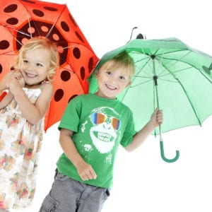 Portrait photograph of kids with umbrellas