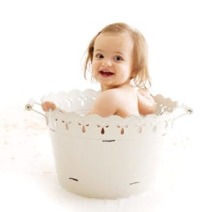 Children's portrait photography of little girl in tin bath