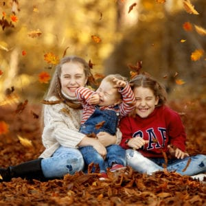Outdoor location portrait photography of kids in autumn leaves
