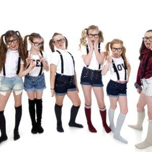 Studio portrait photograph of kids with attitude