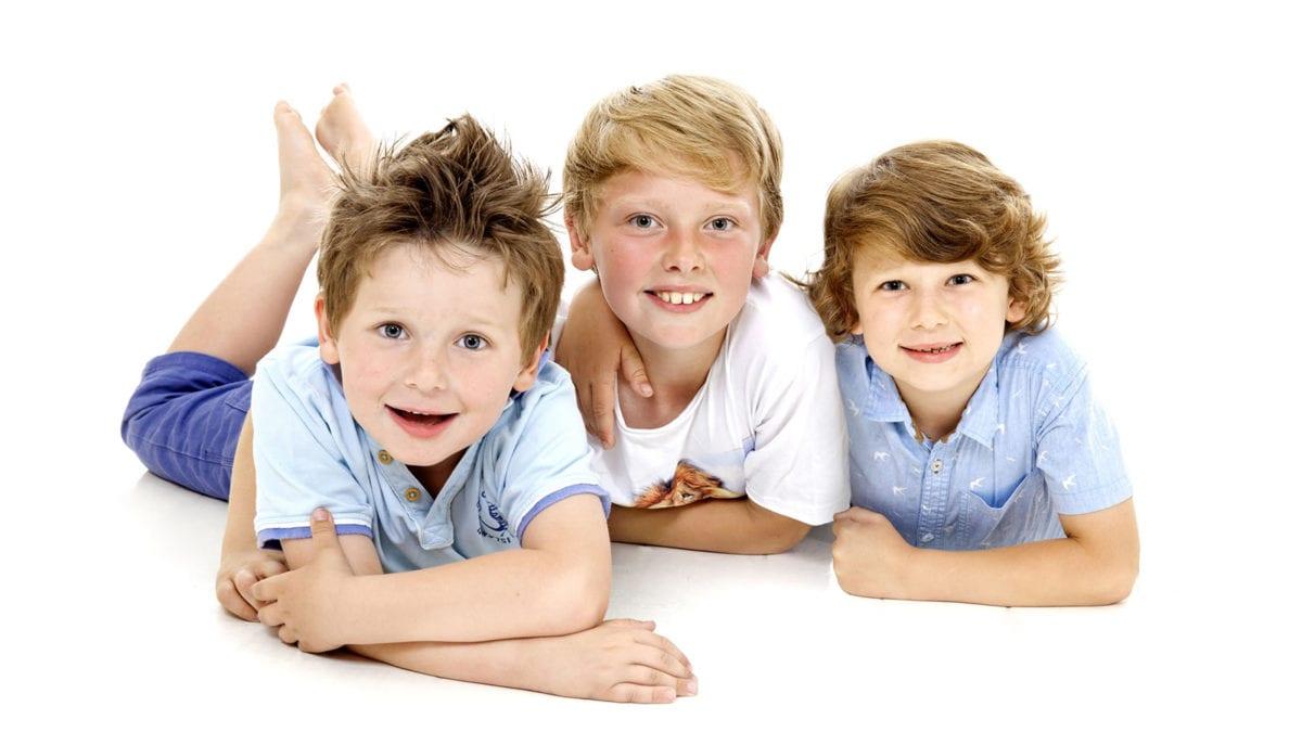 Portrait photograph of three boys in studio