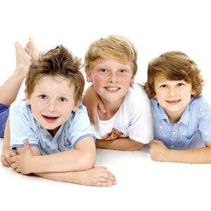 Portrait photograph of three boys in studio