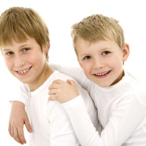 Studio portrait photograph of two young brothers
