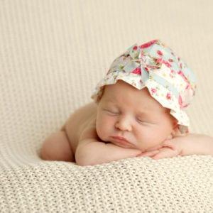Sleeping newborn in hat